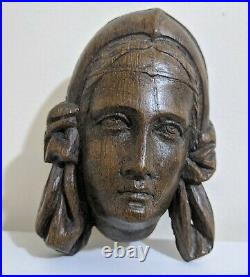 A Fine Early 17th Century Carved Oak Head Of A Maiden