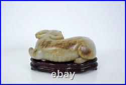 A Finely Carved Celadon and Russet Jade Figure of Buffalo