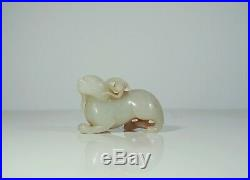 A Finely Carved Jade Mystery Beast with a Monkey