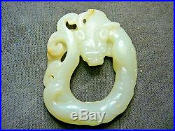 Beautiful finely carved 18th 19thC Chinese white jade dragon pendant