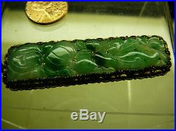 Chinese green jadeite jade translucent finely carved elongated pendant 19/20thC