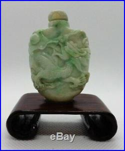 Fine Antique Chinese Jade Snuff Bottle with Dragon Carving on wood base