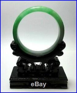 Fine Vintage Chinese green jadeite bracelet on carved wood stand 55mm 44 grams