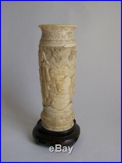 Fine antique Japanese carved bovine bone vase and wooden stand