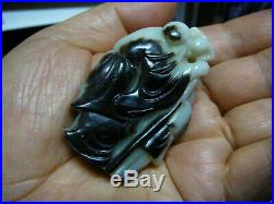 Finely carved Chinese black and white jade old man and child with peach 17th 18thC