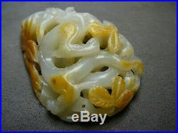 Finely carved reticulated celadon jade dragon pendant with russet Yuan/ Ming 17thC