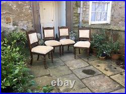 Four Victorian walnut dining chairs with fine carved backs and pearl seats