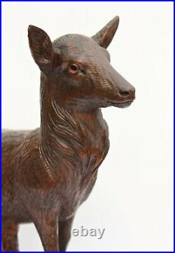 Large pair of finely carved Black Forest deer, 19th Century