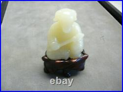 Rare & finely carved Chinese yellowish white jade Zodiac figure of pig on stand