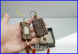 Two Finely Carved Agarwood/Chenxiangmu Pendants, with a metal box