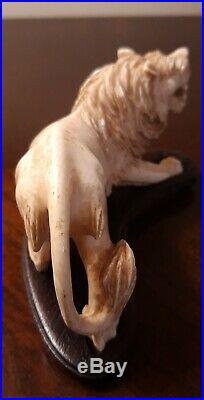 Very fine quality antique carved bovine figure of a roaring lion